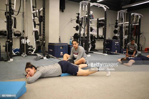 Kia Nurse with Gabby Williams during team warm down and stretching under the supervision of strength coach Amanda Kimball during the UConn Huskies...