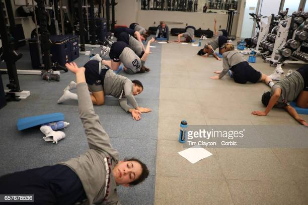 Kia Nurse with teammates as players warm down and stretch under the supervision of strength coach Amanda Kimball during the The UConn Huskies women's...