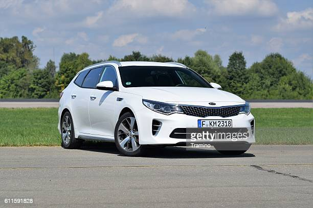 kia optima sw gt on the road - kia stock pictures, royalty-free photos & images