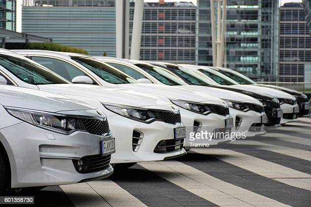 kia optima vehicles on the parking - hybrid car stock photos and pictures