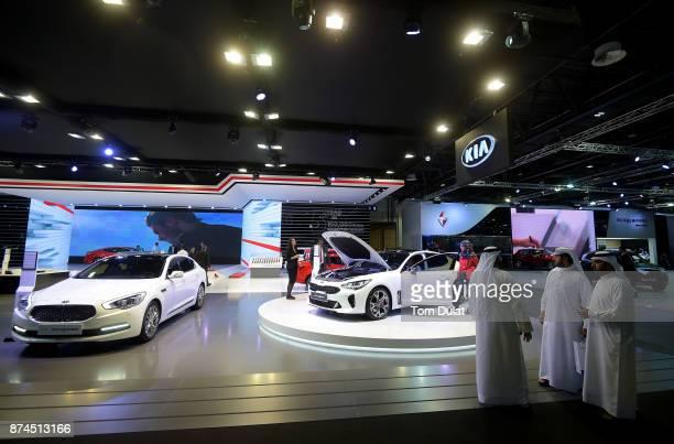 Kia Quoris and Kia Stinger are seen during Dubai Motor Show at Dubai World Trade Centre on November 15 2017 in Dubai United Arab Emirates