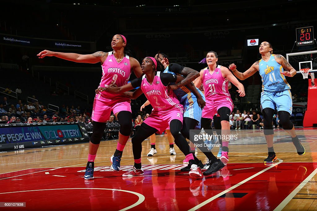 Kia Vaughn #9 and Kahleah Copper #2 of the Washington Mystics react to a play against the Chicago Sky on September 7, 2016 at the Verizon Center in Washington, DC.