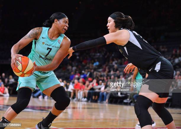 Kia Vaughn of the New York Liberty drives against JiSu Park of the Las Vegas Aces at the Mandalay Bay Events Center on August 15 2018 in Las Vegas...