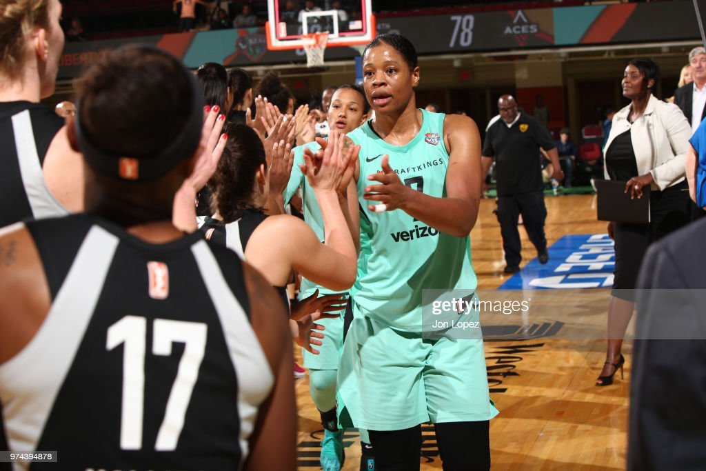 Kia Vaughn #7 of the New York Liberty exchanges handshakes with the Las Vegas Aces after the game on June 13, 2018 at Westchester County Center in White Plains, New York.
