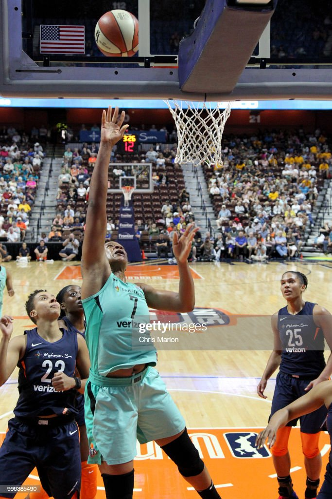 Kia Vaughn #7 of the New York Liberty goes to the basket against the Connecticut Sun on July 11, 2018 at the Mohegan Sun Arena in Uncasville, Connecticut.
