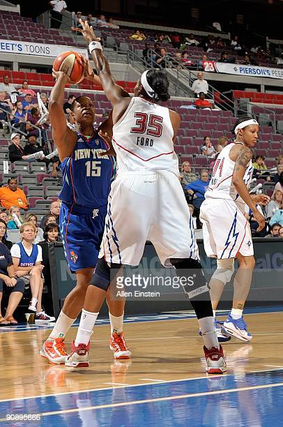 Kia Vaughn of the New York Liberty looks to shoot over Cheryl Ford of the Detroit Shock during the WNBA game on September 10 2009 at The Palace of...