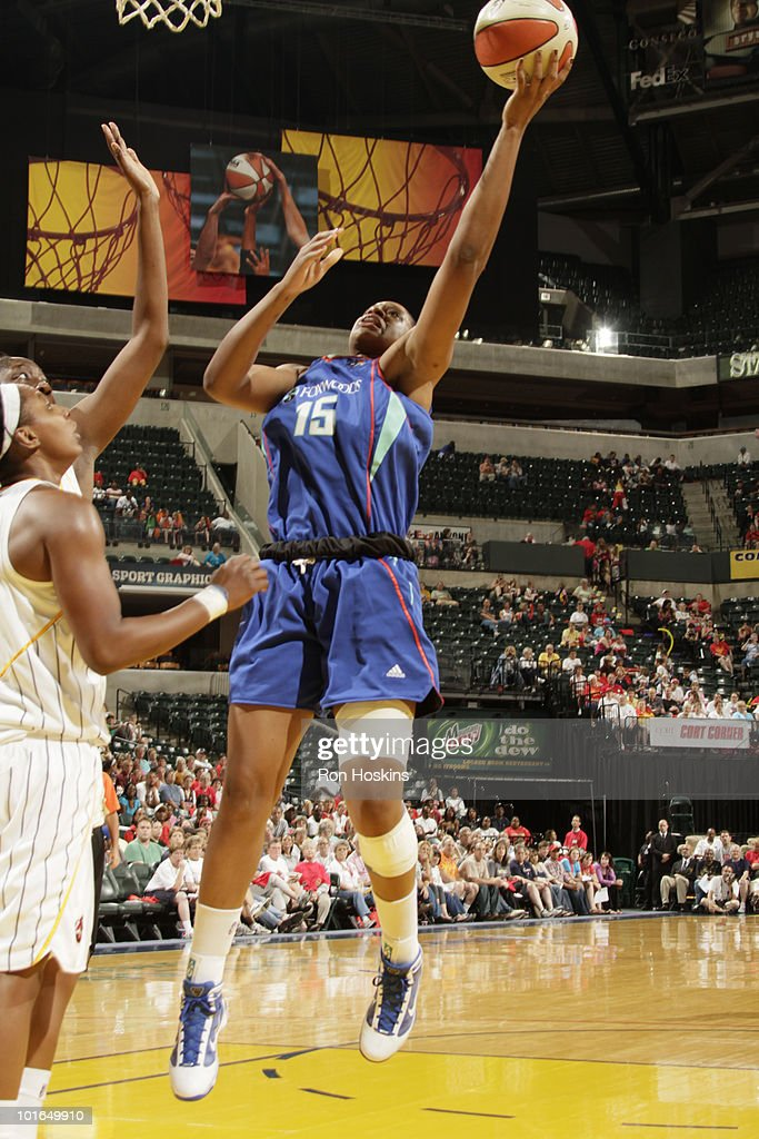 Kia Vaughn #15 of the New York Liberty shoots over several Indiana Fever defenders at Conseco Fieldhouse on June 5, 2010 in Indianapolis, Indiana. The Fever defeated the Liberty 78-73.