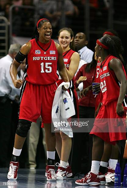 Kia Vaughn of the Rutgers Scarlet Knights celebrates from the bench with teammates against the LSU Lady Tigers during the National Semifinal game of...