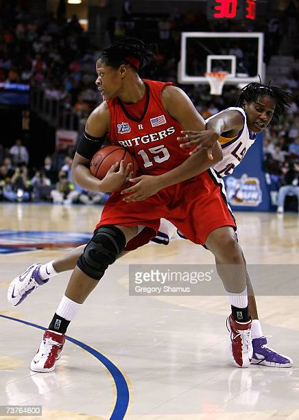 Kia Vaughn of the Rutgers Scarlet Knights controls the ball against Quianna Chaney of the LSU Lady Tigers during the National Semifinal game of the...