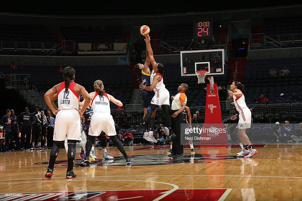 Kia Vaughn #9 of the Washington Mystics and Erlana Larkins #2 of the Indiana Fever tip off Game Two of the Eastern Conference Semifinals during the 2014 WNBA Playoffs on August 23, 2014 at the Verizon Center in Washington, DC.