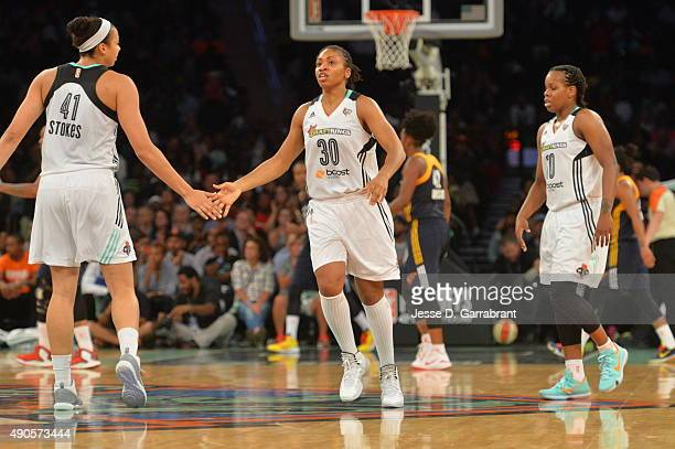 Kiah Stokes and Tanisha Wright of the New York Liberty shake hands against the Indiana Fever during game Three of the WNBA Eastern Conference Finals...
