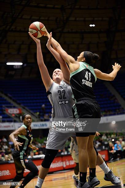Kiah Stokes of the New York Liberty blocks the shot of Jayne Appel of the San Antonio Stars on August 19 2015 at the Freeman Coliseum in San Antonio...
