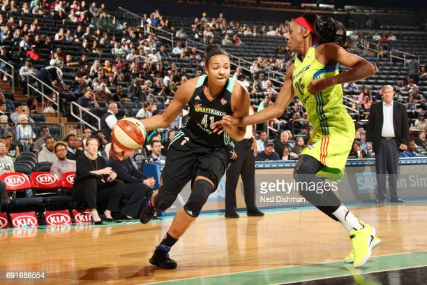 Kiah Stokes of the New York Liberty drives to the basket against Glory Johnson of the Dallas Wings during a game on June 2 2017 at Madison Square...