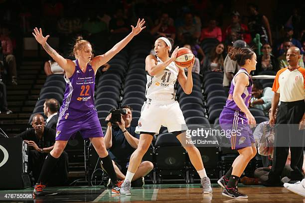 Kiah Stokes of the New York Liberty looks to pass against the Phoenix Mercury during a WNBA game on June 11 2015 at Madison Square Garden in New York...