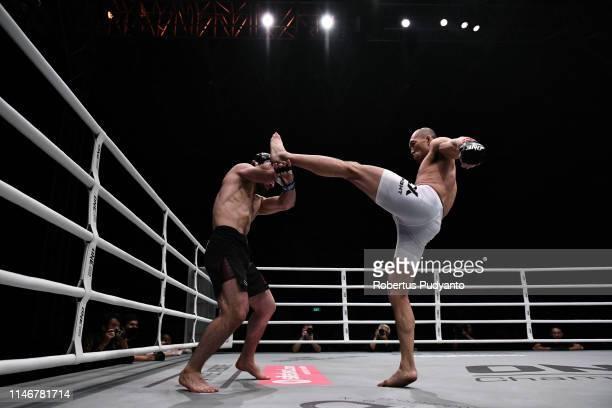 Kiamrian Abbasov of Kyrgyzstan fights against Yushin Okami of Japan during ONE Championship Welter Weight at Istora Senayan on May 03, 2019 in...