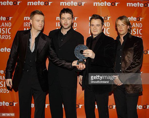 Kian Egan Mark Feehily Shane Filan and Nicky Byrne of Westlife pose with their award for Best Irish Pop Act at The Meteor Ireland Music Awards 2006...