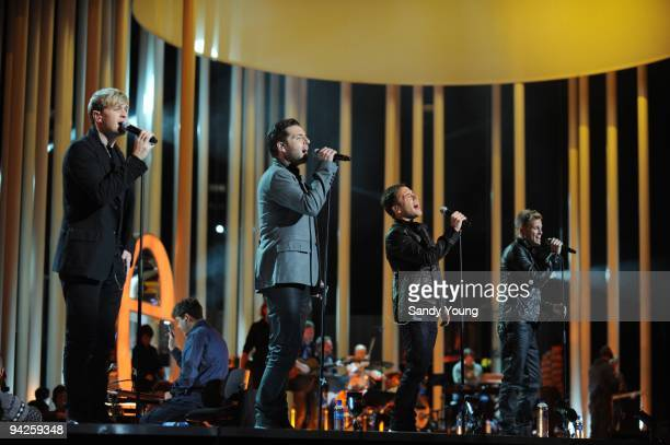 Kian Egan Mark Feehily Shane Filan and Nicky Byrne of Westlife perform during the Nobel Peace Prize Concert Rehearsals at Oslo Spektrum on December...