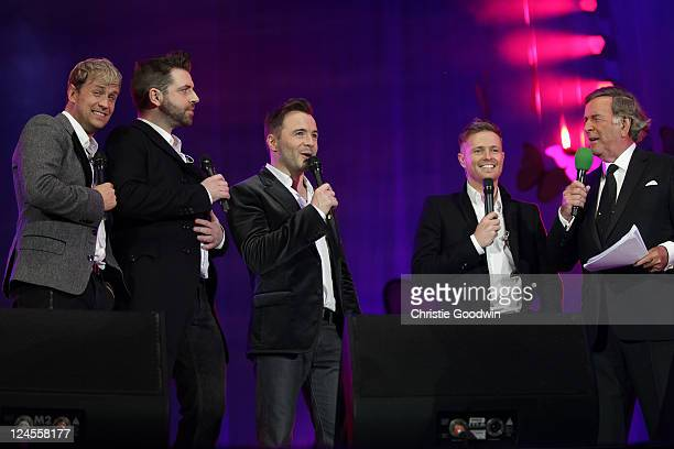 Kian Egan Mark Feehily Shane Filan Nicky Byrne and Sir Terry Wogan on stage at BBC Proms In The Park at Hyde Park on September 10 2011 in London...
