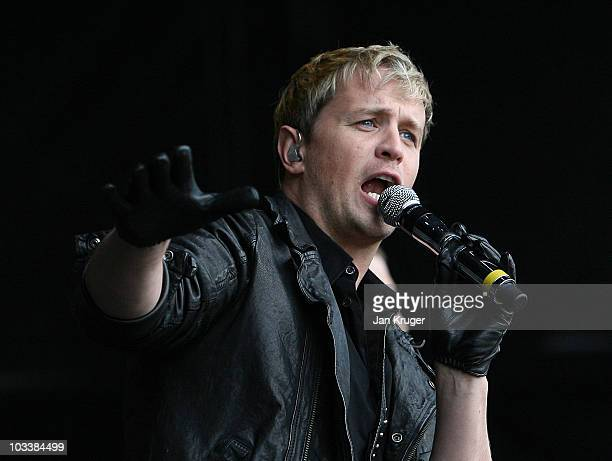 Kian Egan of Westlife performs at Newbury Races during Ladies Day at Newbury racecourse on August 14 2010 in Newbury England