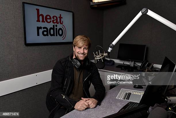 Kian Egan poses as he is unveiled as heat radio's new presenter at heat radio on March 16 2015 in London England