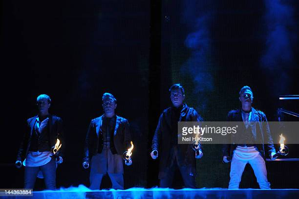 Kian Egan Shane Filan Mark Feehily and Kian Egan of Westlife performs on stage at Motorpoint Arena on May 13 2012 in Sheffield United Kingdom