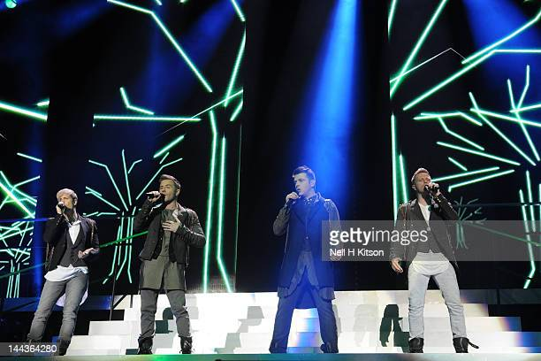 Kian Egan, Shane Filan, Mark Feehily and Nicky Byrne of Westlife performs on stage at Motorpoint Arena on May 13, 2012 in Sheffield, United Kingdom.