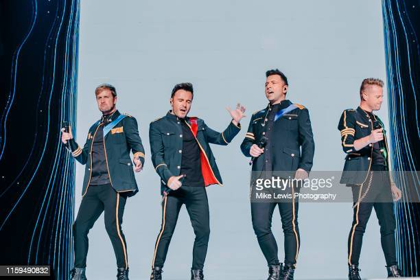 Kian Egan, Shane Filan, Markus Feehily and Nicky Byrne of Westlife perform on stage at Motorpoint Arena on July 01, 2019 in Cardiff, Wales.
