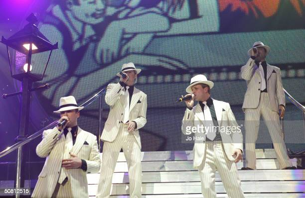 Kian Egan Shane Filan Nicky Byrne and Mark Feehily of boy band Westlife perform on stage during their London stop of the UK tour promoting their...