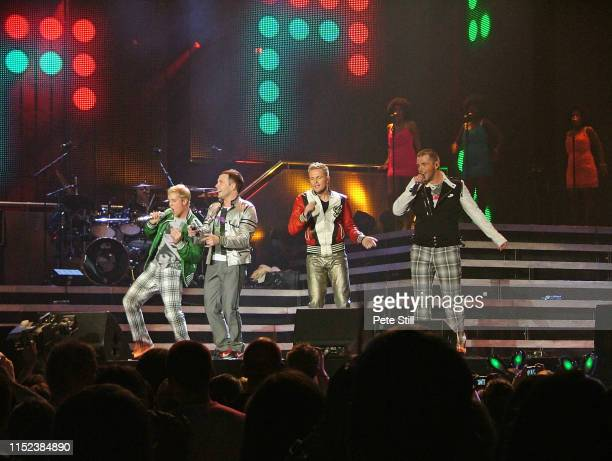 Kian Egan Shane Filan Nicky Byrne and Mark Feehily of Irish boy band Westlife perform on stage at Hammersmith Odeon on March 29th 2008 in London...