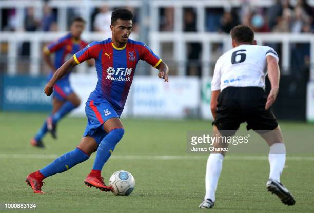 Kian Flanagan of Crystal Palace attempts to get past Jack Holland of Bromley FC attempts to block during the preseason friendly match between Bromley...