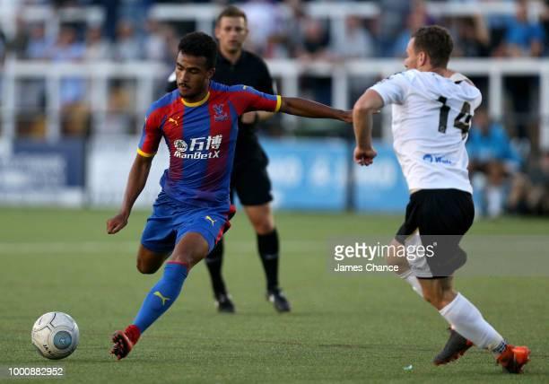Kian Flanagan of Crystal Palace shoots as Jordan Higgs of Bromley attempts to block during the preseason friendly match between Bromley and Crystal...