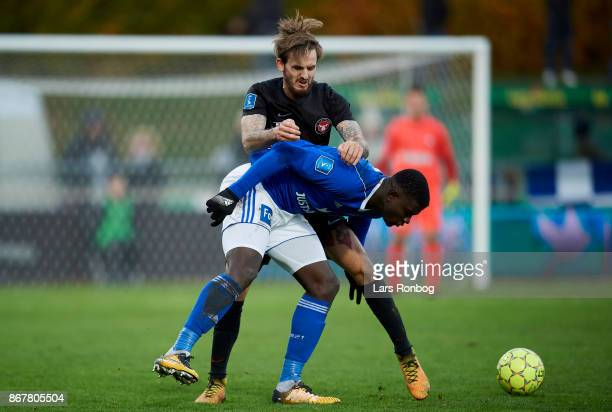 Kian Hansen of FC Midtjylland and Mayron George of Lyngby BK compete for the ball during the Danish Alka Superliga match between Lyngby BK and FC...