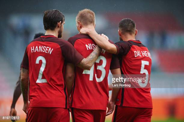 Kian Hansen Rasmus Nissen and Marc Dal Hende of FC Midtjylland celebrate after scoring their first goal during the UEFA Europa League Qualification...