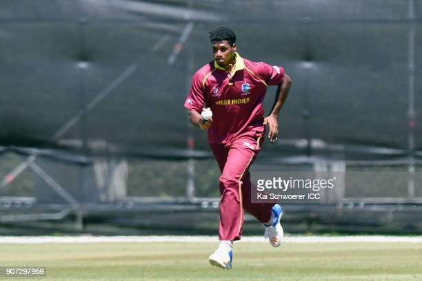 Kian Pemberton of the West Indies runs in to bowl during the ICC U19 Cricket World Cup match between the West Indies and Kenya at Lincoln Oval on...