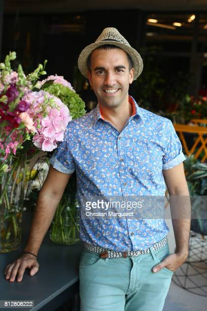 Kian ShamsDolatabadi poses for a portrait during the 'Kians Garden Flower Shop' Opening Event at Kantstrasse on July 11 2017 in Berlin Germany