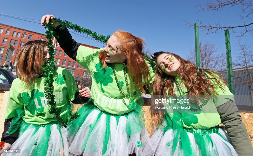 Kiana Gratton, Hannah Leavitt and Kayleigh Smith, all of Saco, put on the green while waiting to line up with Carpenters Local 1996 of Saco in the Irish American Club's annual St. Patrick's Parade on Commercial Street.