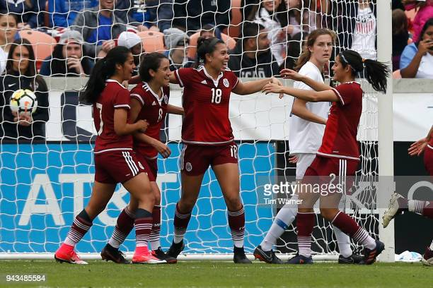Kiana Palacios of Mexico is congratulated by Kenti Robles and Ariana Calderon after a goal in the first half against the United States at BBVA...