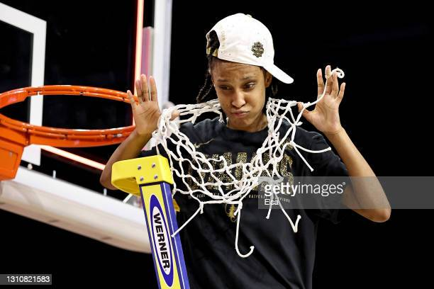 Kiana Williams of the Stanford Cardinal celebrates after cutting down the net following the team's win against the Arizona Wildcats in the National...