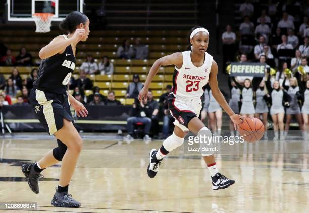 Kiana Williams of the Stanford Cardinal dribbles past the defense of Quinessa CaylaoDo of the Colorado Buffaloes during the second quarter of a game...