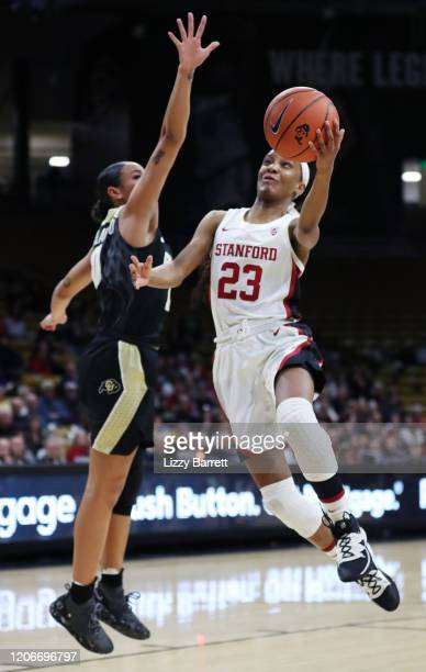 Kiana Williams of the Stanford Cardinal makes a lay up past the defense of Quinessa CaylaoDo of the Colorado Buffaloes during the second quarter of a...