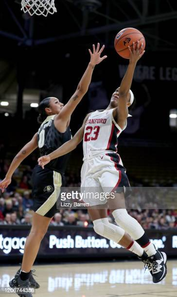 Kiana Williams of the Stanford Cardinal makes lay up past the defense of Quinessa CaylaoDo of the Colorado Buffaloes during the second quarter of a...