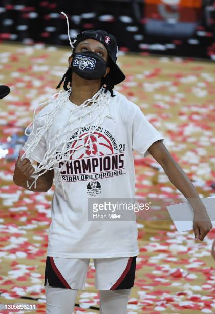 Kiana Williams of the Stanford Cardinal wears a net around her neck after it was cut down by her head coach Tara VanDerveer following the team's...