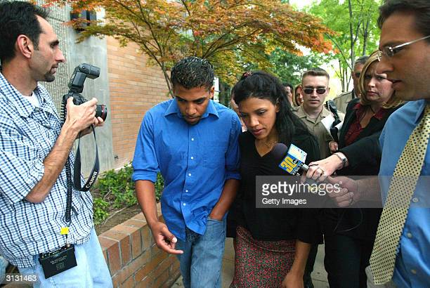 Kiani and Almae Wesson walks in front of Fresno Superior Court after their father Marcus Wesson was arraigned for the slayings of nine of his family...