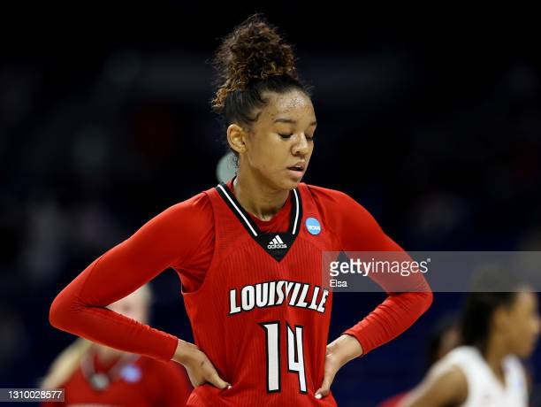 Kianna Smith of the Louisville Cardinals react to the loss to the Stanford Cardinal during the Elite Eight round of the NCAA Women's Basketball...