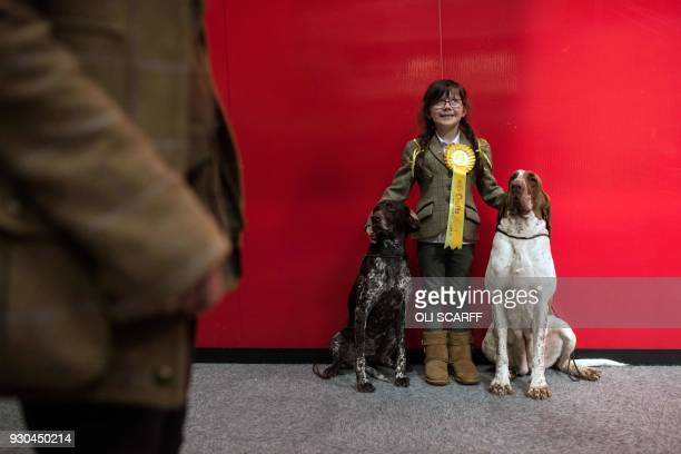 Kiara aged 6 poses for a photograph with her dogs on the left 'Madison' a German Short Haired Pointer and 'Fenn' the Bracco Italiano on the final day...
