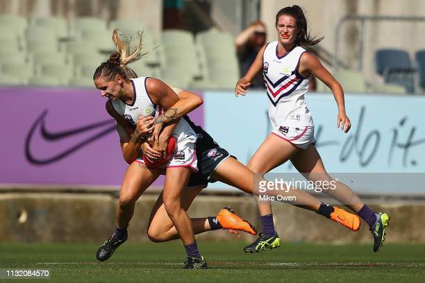 Kiara Bowers of the Dockers is tackled by Tayla Harris of the Blues during the AFLW Preliminary Final match between the Carlton Blues and the...
