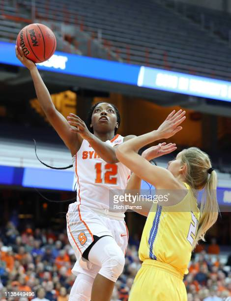 Kiara Lewis of the Syracuse Orange shoots the ball over the defense of Tylee Irwin of the South Dakota State Jackrabbits during the second half in...