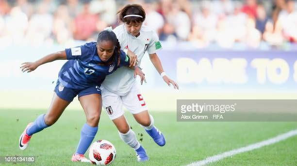 Kiara Pickett of the United States is challenged by Hinata Miyazawa of Japan during the FIFA U20 Women's World Cup France 2018 group C match between...