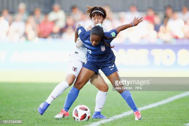 Kiara Pickett of the United States is challenged by Hinata Miyazawa of Japan during the FIFA U-20 Women's World Cup France 2018 group C match between...