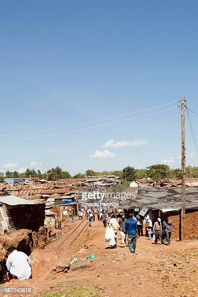 CONTENT] Kibera one of the biggest informal settlements in Africa The Uganda Railway line runs through the heart of Kibera